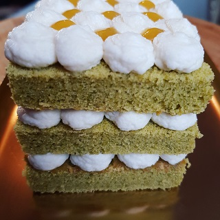 Pistachio cake with whipped cream and apricot puree
