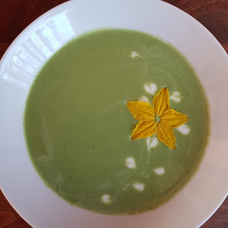 Spinach soup granished with cucumber flower